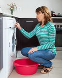 Adult woman doing laundry Royalty Free Stock Photos