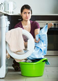 Adult woman doing laundry at home Royalty Free Stock Image