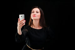 Adult woman doing self photo Royalty Free Stock Images