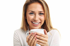 Adult woman drinking cup of tea coffee isolated over white. Picture of adult woman drinking cup of tea coffee isolated over white royalty free stock photo