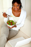 Adult woman eating healthy green salad Stock Photos