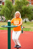 Adult woman exercising Royalty Free Stock Image