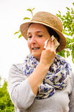 Adult woman farmer sweat tissue clean cheek head Stock Photo