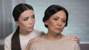 Adult woman feeling loneliness, daughter supporting mother, help of close friend stock footage