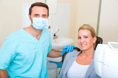 Adult woman getting her checkup at the Dentist Stock Image