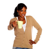 Adult woman giving you a mug Royalty Free Stock Photography