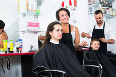 Adult woman hairdresser cutting female client Royalty Free Stock Image
