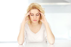 Adult woman having headache at home Royalty Free Stock Images