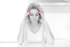 Adult woman having headache at home Stock Image