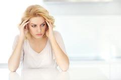 Adult woman having headache at home Stock Photos