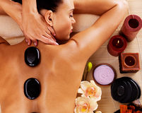 Adult woman having hot stone massage in spa salon. Beauty treatment concept Royalty Free Stock Image