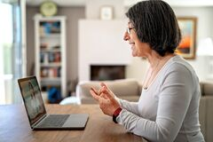 Free Adult  Woman Having Video Chat Online On Laptop With Her Granddaughter At Home During Quarantine Isolation Royalty Free Stock Images - 178370699