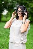 Adult woman in headphones Stock Photo