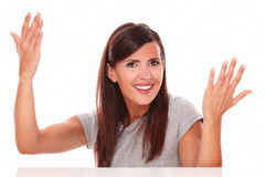 Adult woman with her hands up looking at camera Royalty Free Stock Images