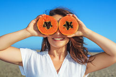 Adult woman hold in hands ripe fruit - orange papaya Royalty Free Stock Images