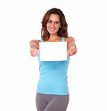 Adult woman holding a blank card Royalty Free Stock Image
