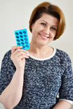 Adult woman holding a blister pack of pills Royalty Free Stock Images