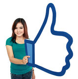 Adult woman holding like symbol Stock Image