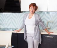 Adult woman on kitchen Royalty Free Stock Photography