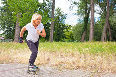 Adult woman in-line skating Royalty Free Stock Photo
