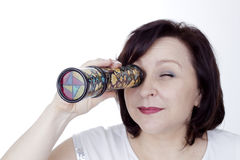 Adult woman looking into a kaleidoscope Stock Photography