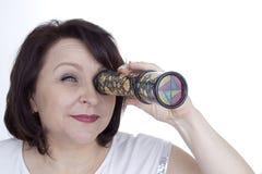 Adult woman looking into a kaleidoscope stock photos