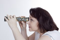 Adult woman looking into a kaleidoscope stock photo