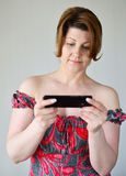 Adult woman looking at mobile phone Stock Photo