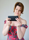 Adult woman looking at mobile phone Stock Image