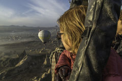 Adult woman looking at the scenery from a balloon Stock Photography