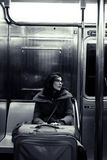 Woman with Suitcase in New-York Subway Royalty Free Stock Image