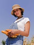 Adult woman with maize Royalty Free Stock Images