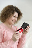 adult woman makes a purchase from your mobile phone by credit card Stock Images