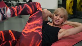 Adult woman on mate doing press exercises 4K Slow Mo stock video