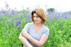 Adult woman with neurodermatitis on the Meadow Royalty Free Stock Photography