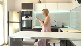 Adult woman with phone at home. Female with mobile phone communication stock video