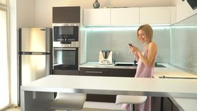 Adult woman with phone at home. Female with mobile phone communication stock footage