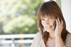 Adult woman on the phone. Adult woman smiling on the phone Stock Photo