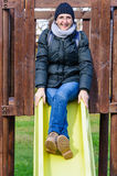 Adult woman at playground Royalty Free Stock Images