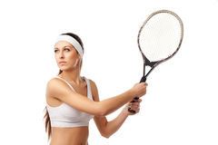 Adult woman playing tennis. Stock Photos