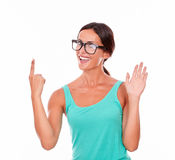 Adult woman pointing at copy space Royalty Free Stock Images