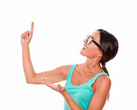Adult woman pointing at copy space Royalty Free Stock Photo