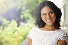 Adult woman portrait. Happy latin woman portrait smiling outdoors Stock Photo