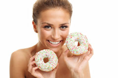 Adult woman posing with donuts over white background. Picture of adult woman posing with donuts over white background Stock Photos