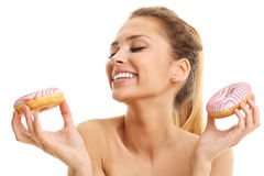Adult woman posing with donuts over white background. Picture of adult woman posing with donuts over white background Royalty Free Stock Image