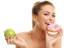 Adult woman posing with donuts over white background. Picture of adult woman posing with donuts over white background Royalty Free Stock Images