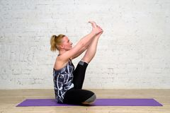 Adult woman practicing yoga. The adult woman practicing yoga Royalty Free Stock Photography