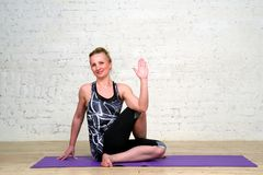 Adult woman practicing yoga Royalty Free Stock Photography