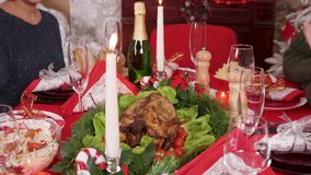 Adult woman putting down on the christmas table delicious turkey
