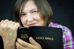 Adult Woman Reading a Bible Royalty Free Stock Image